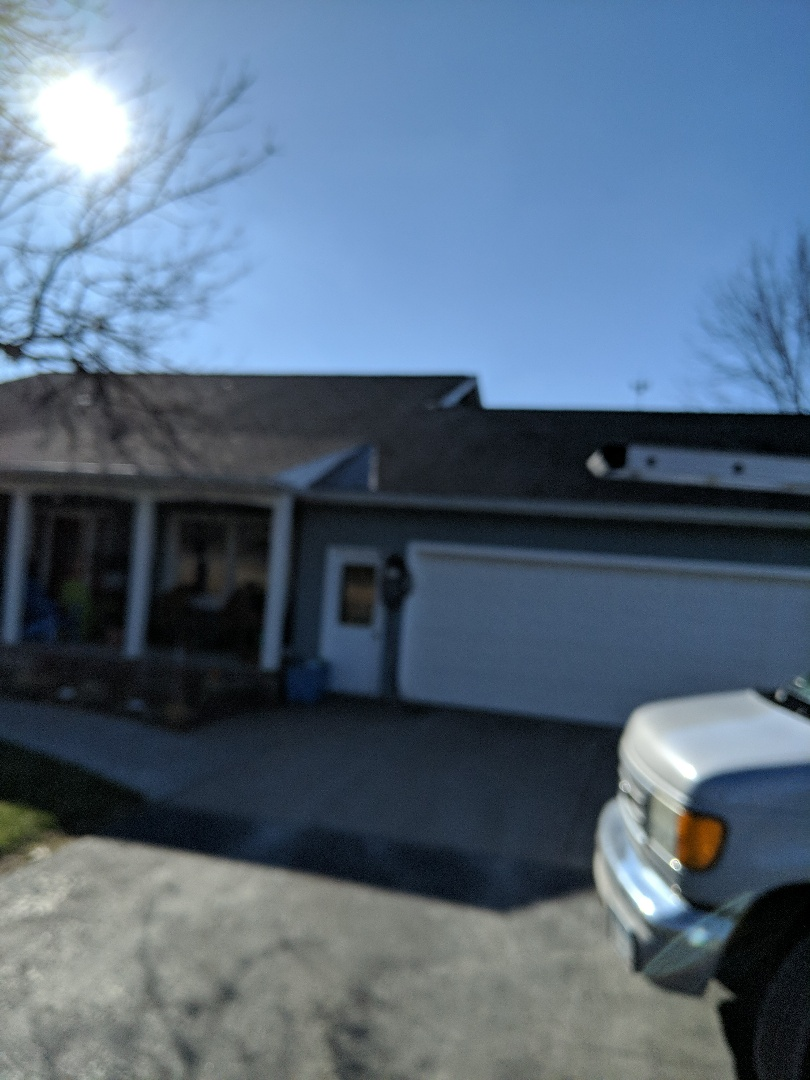 River Falls, WI - Customer has a leak roof to wall on the back side of the house we're working on step flashing to repair it