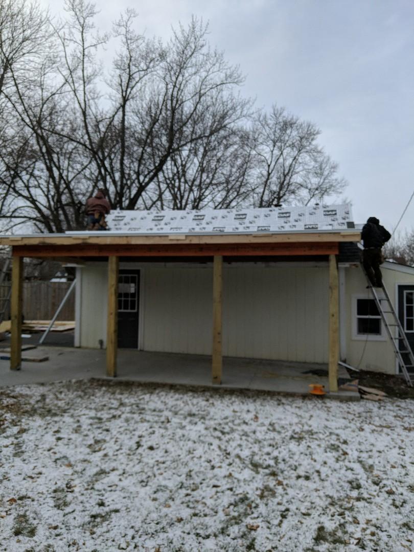 Hudson, WI - Working on flat roof garage addition in Hudson Wisconsin installing certain landmark asphalt shingles