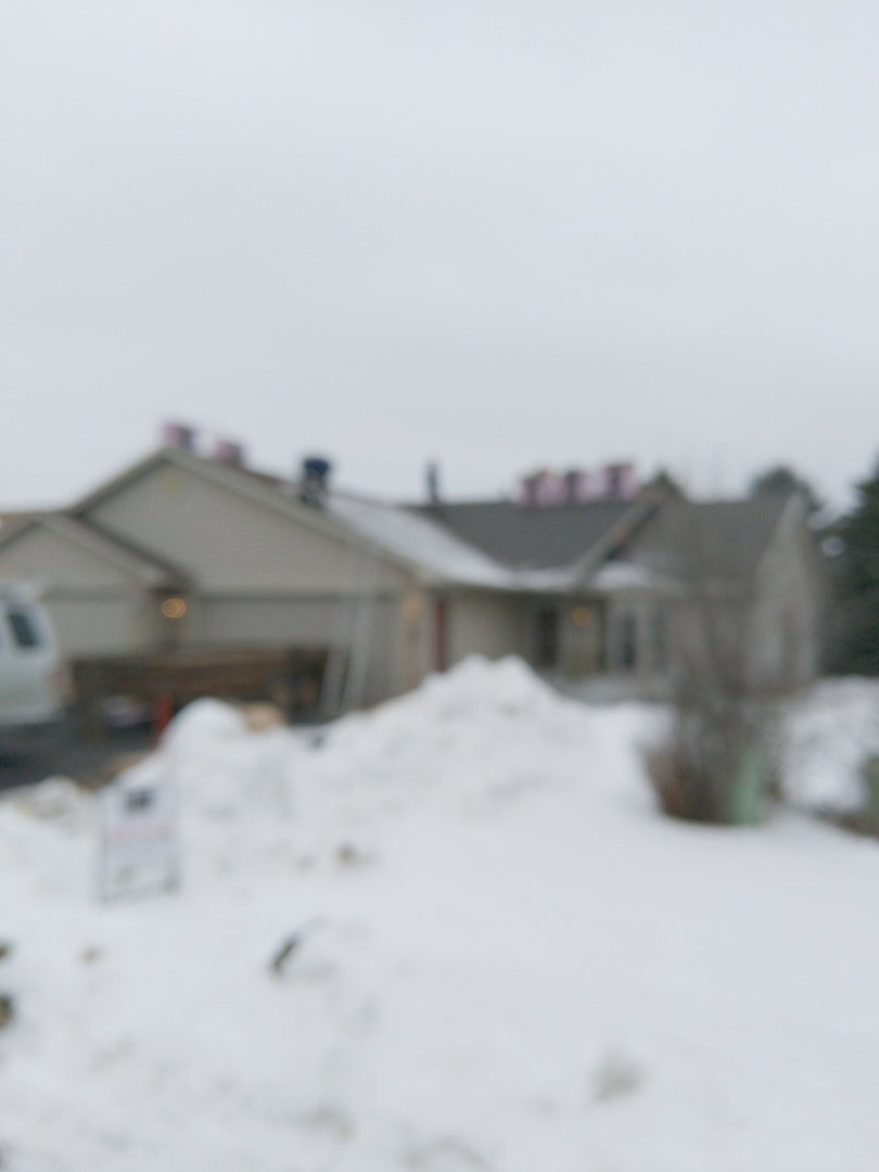Hudson, WI - Installing Owens Corning duration brownwood shingles in a rare install in the winter.