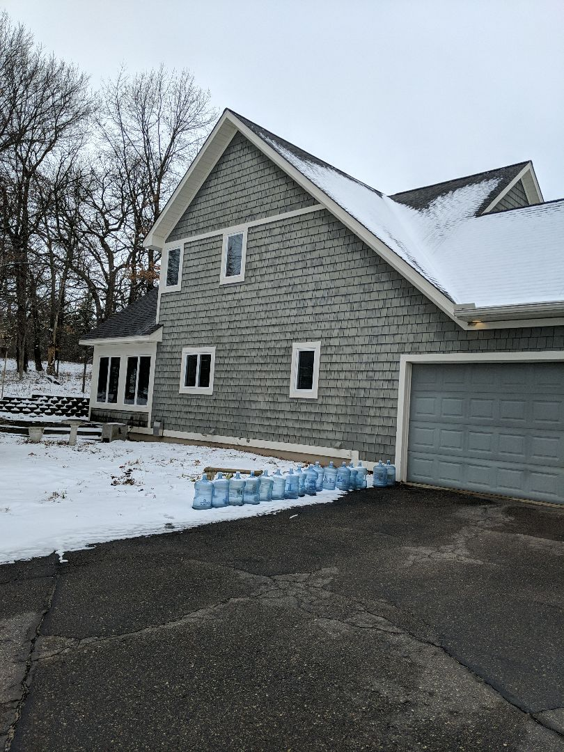 Lake Elmo, MN - P providing estimate to reside entire home with LP smart trim LP smart siding and LP lap board and battened siding. Looking to install some Anderson Windows new clopay or chi garage doors with lights and new patio door.