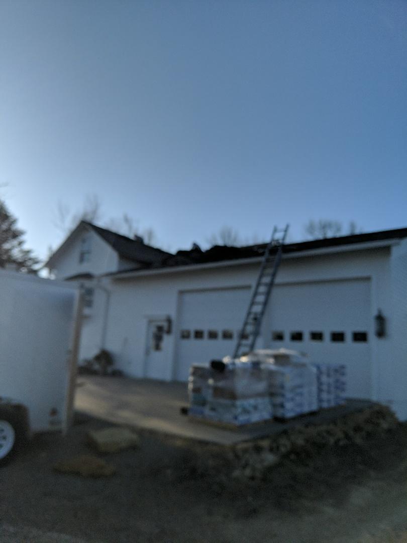 River Falls, WI - Installing shingles at a farm home installing storm Gray SBS rubberized malarkey vista shingles