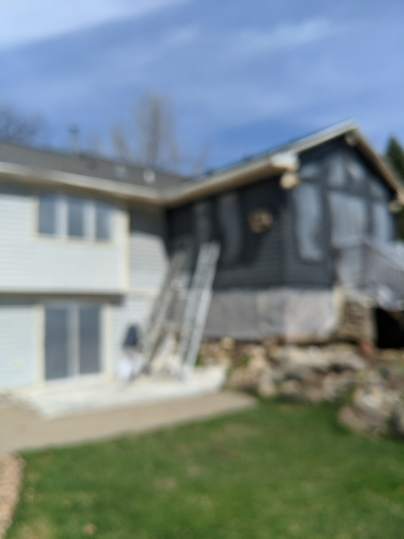 River Falls, WI - Painting still siding on home soffit and fascia entire home with Sherwin-Williams paint duration