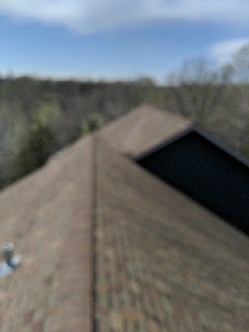 Prescott, WI - Inspecting asphalt roof looking at certainty New horizon shingles that are under warranty to determine whether or not they need to be replaced