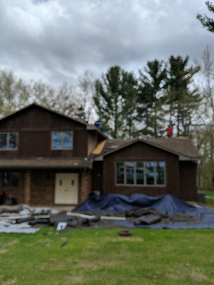 River Falls, WI - Installing asphalt roof CertainTeed landmark in the heather blend adding new ridge vent and extra ice and water. Taking sample shingle for certainty New horizon claim