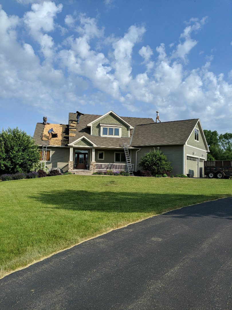 Hudson, WI - Starting a new roof here in Hudson wisconsin. Installing Northgate by CertainTeed in a weathered wood Max definition using open valleys and ridge penny. Customer had leak between new four season room and house so installing new step flashing and ice and water along that area