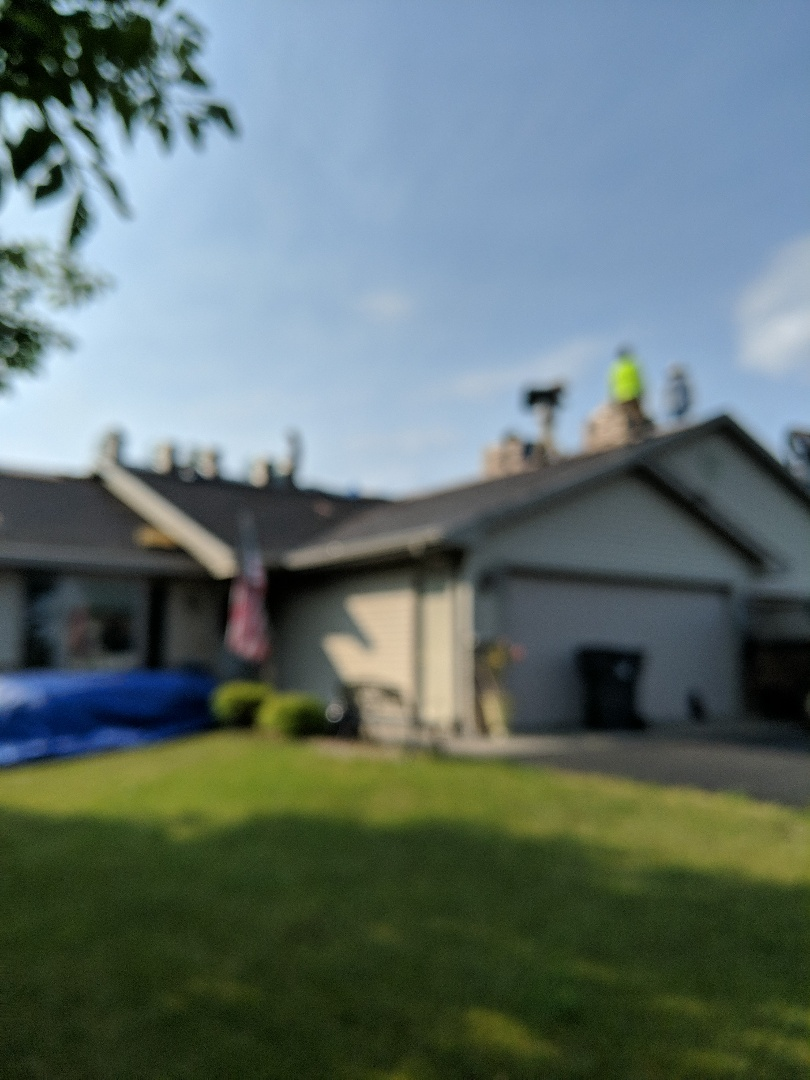 Roberts, WI - Starting work on a twin home installing asphalt shingles Landmark heather blend to both sides. Wind damage repair and rear roof. Processing shingle claim for certainty New horizons