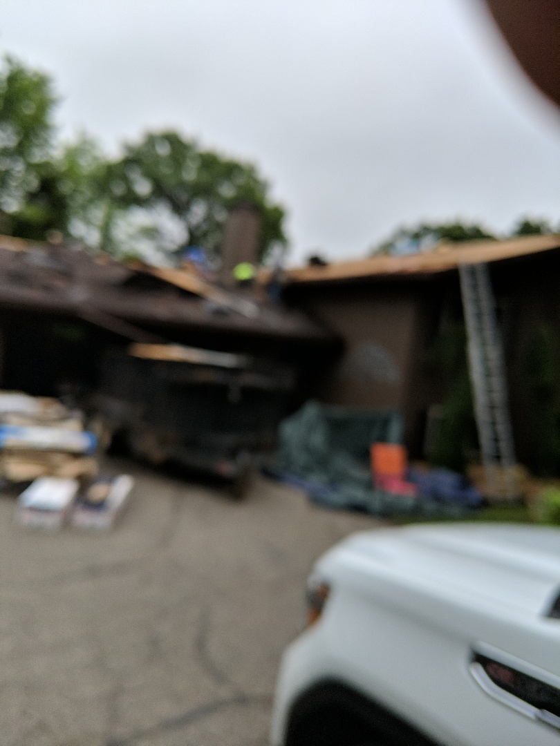 Prescott, WI - Installing new roof with CertainTeed Landmark Pro with the max definition burnt sienna. Replacing some half inch plywood roof is three layers