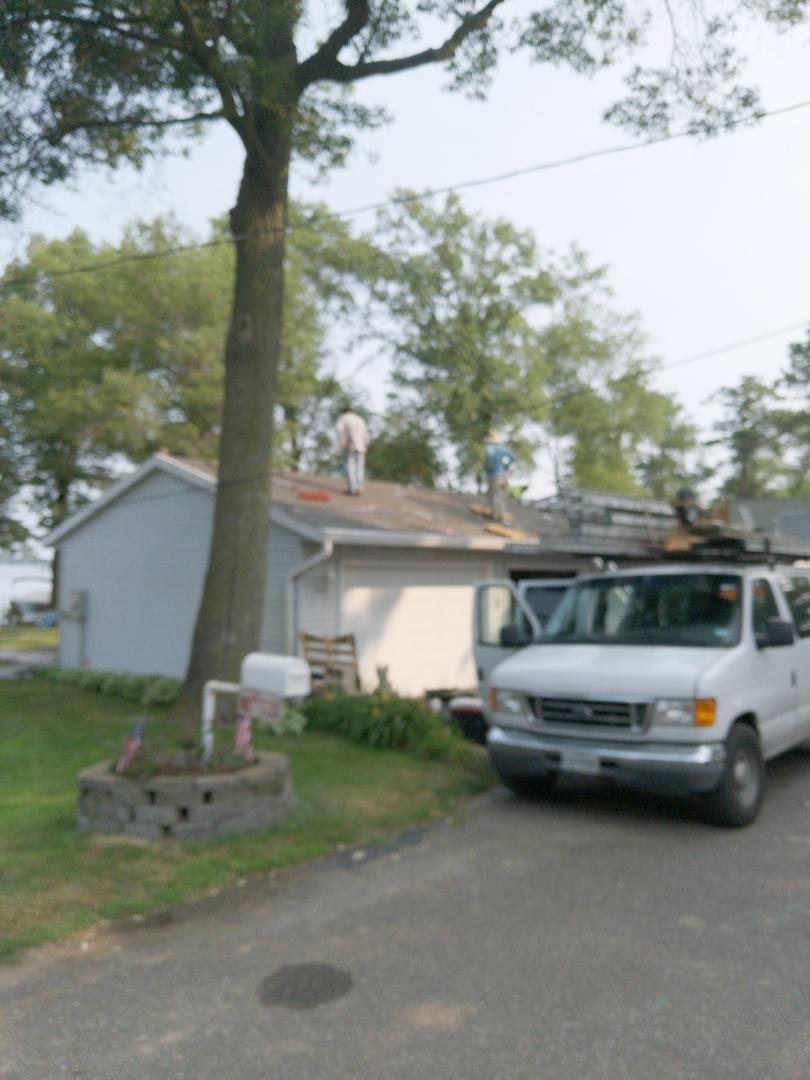 Amery, WI - Installing pewter color CertainTeed Landmark asphalt shingles I'm home after hail storm damage