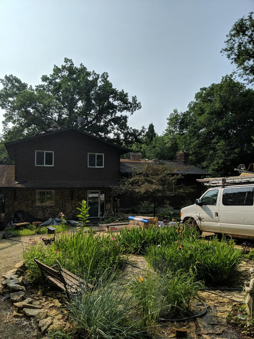 River Falls, WI - Installing Landmark Pro by CertainTeed in the weathered wood on home that has 25-year-old roof. Chimney flashings new ridge venting by cobra snow country