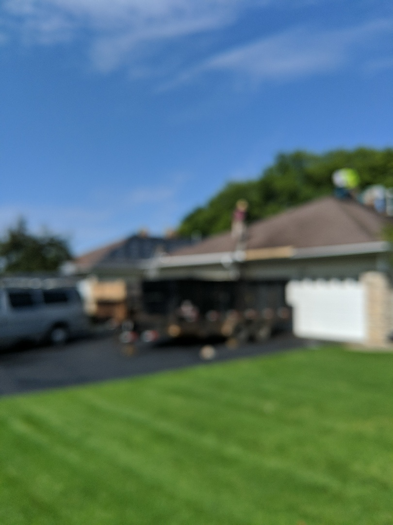 Hudson, WI - Starting another homeowners association rough with installation of CertainTeed landmark asphalt shingles burnt sienna