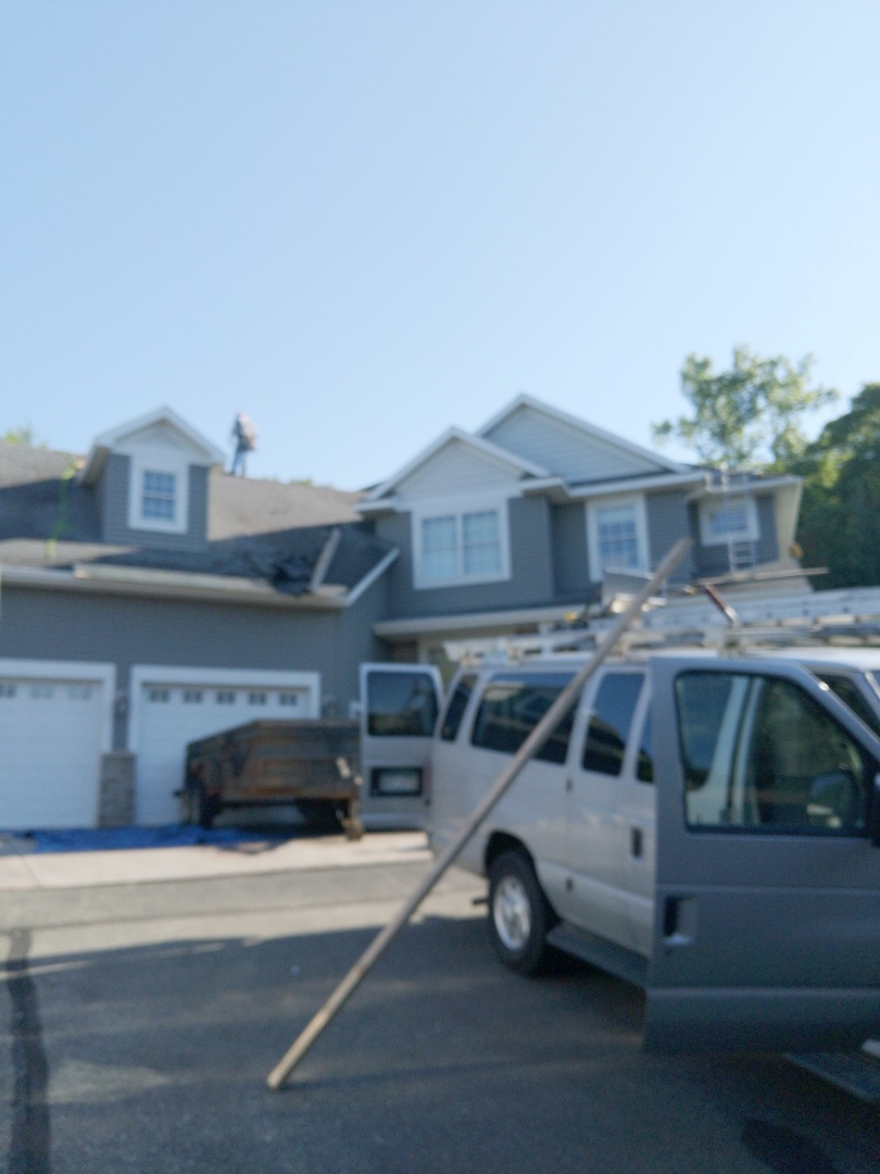Prescott, WI - Starting new asphalt roofing project using CertainTeed landmarks in the color Maury black.