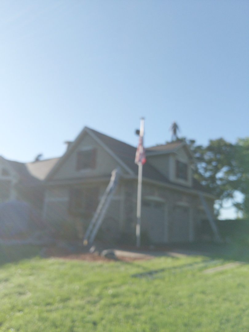 Prescott, WI - Installing CertainTeed Northgate Max definition burnt sienna along with ridge venning and special roof to wall flashing to repair leaks