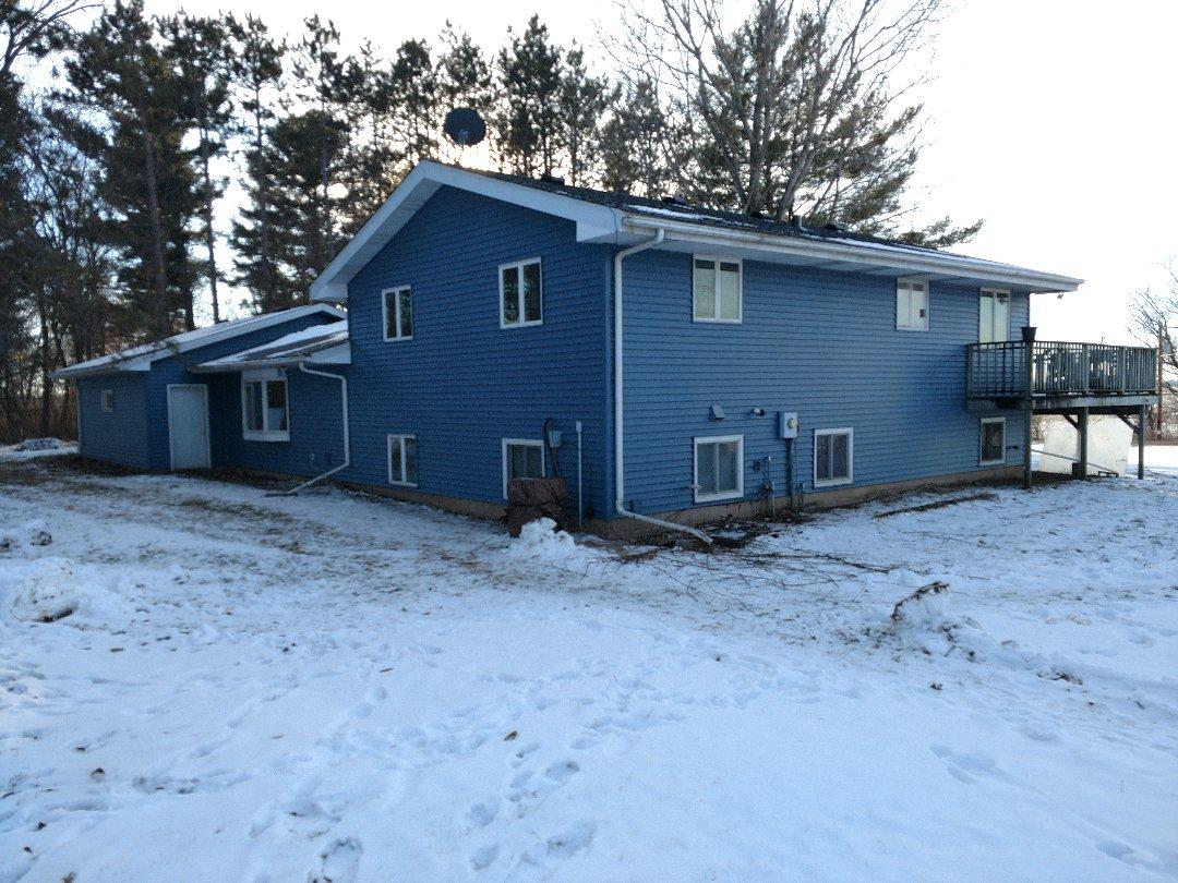 New Richmond, WI - Installation of vinyl siding in new Richmond Wisconsin.  Market Square regatta blue d-4
