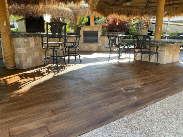 Sitka, AK - Transform your patio to a Tiki paradise get-away with Rustic Wood and Graniflex Flakes! Give us a call for your vacation at home patio dream!!