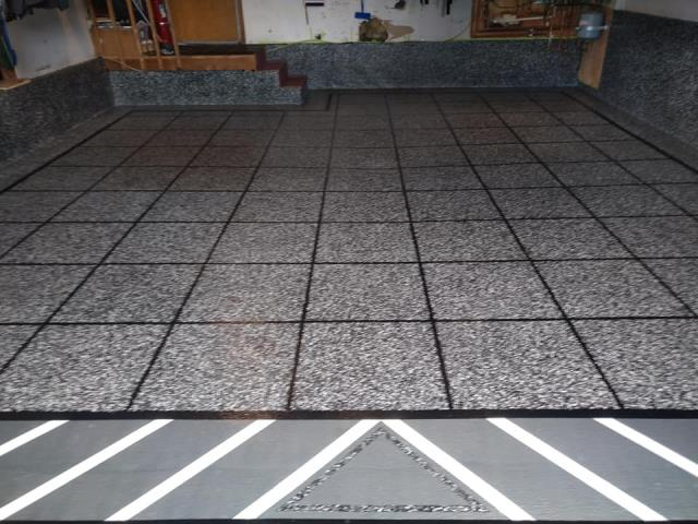 Kenai, AK - Want a garage that resembles your personality? With Graniflex and Epoxy Flake, anything is possible! Even sparkly floors!