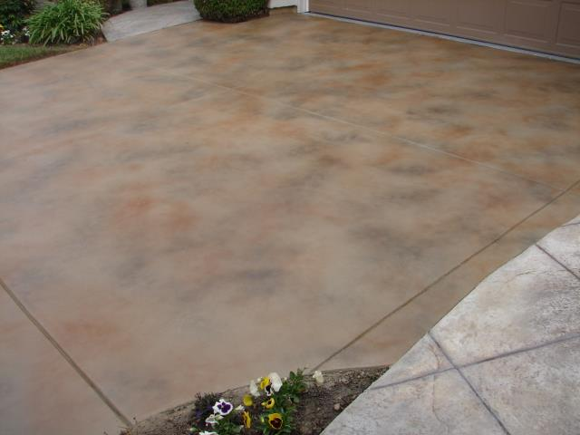 Rapid City, SD - Have a vision for your exterior home appeal that includes a fabulous driveway? Give us a call about our Slate Stained Concrete system and more!