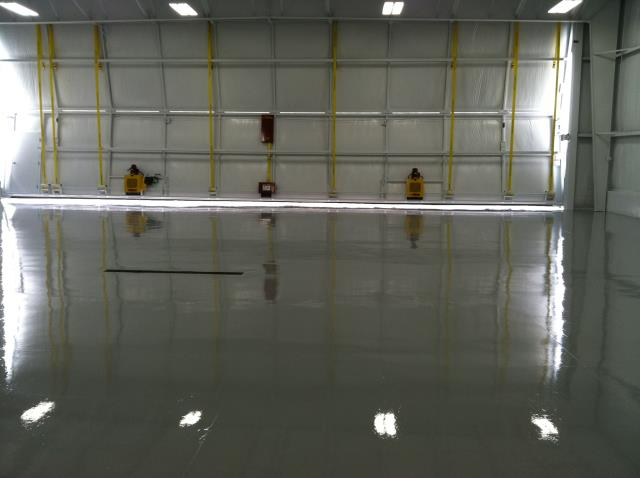 Juneau, AK -  Hanger space flooring not capable of handling heave machinery anymore? Transform and protect for years to come with our systems! Add personality to a boring floor while your at it!!