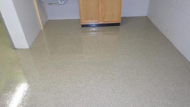 Kenai, AK - Job done well on this office floor! The entire ground looks great, I can't imagine anything being able to be higher quality. The edges along the wall look perfect, I would think this floor has been there the entire time. Love the epoxy flake look too! TNT Specialty Coatings is the golden standard!