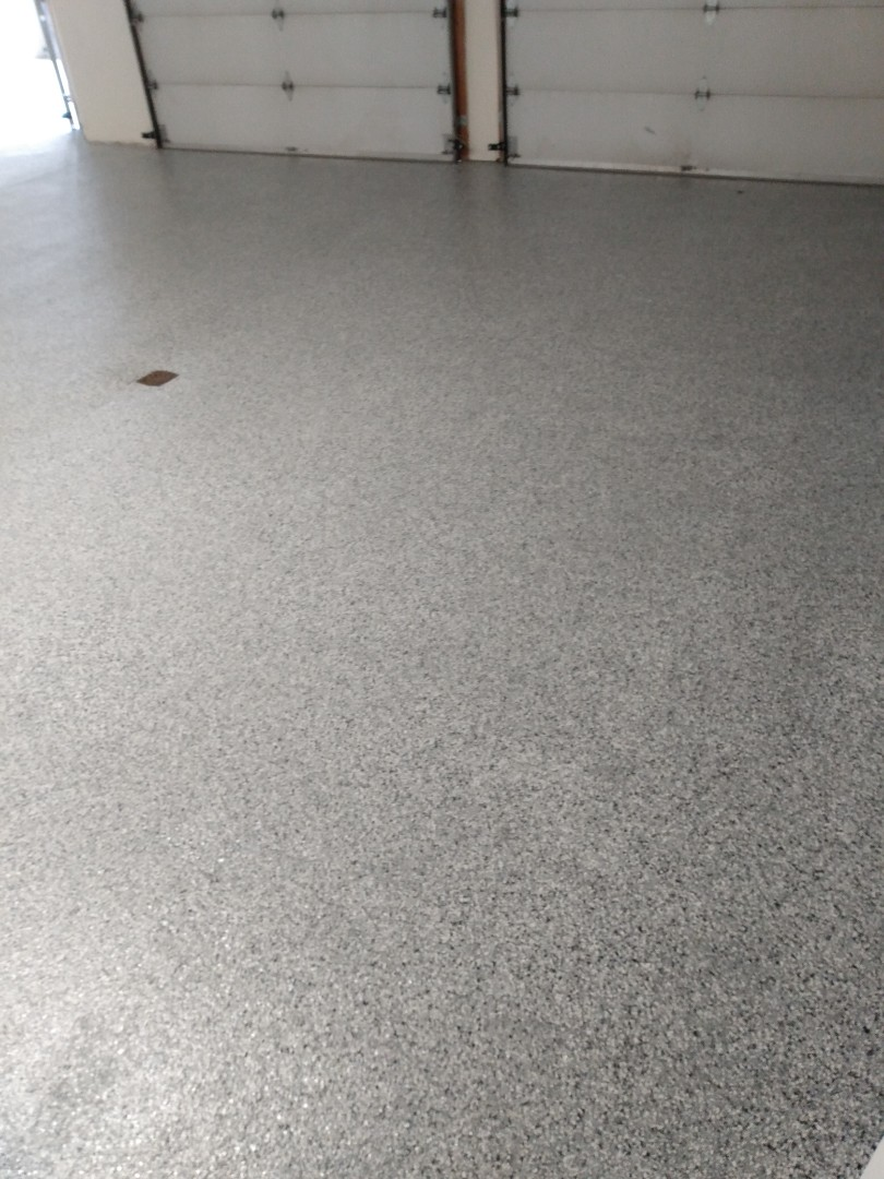 The team is working on a concrete garage floor resurfacing job with a flake system. Near Palmer Alaska.