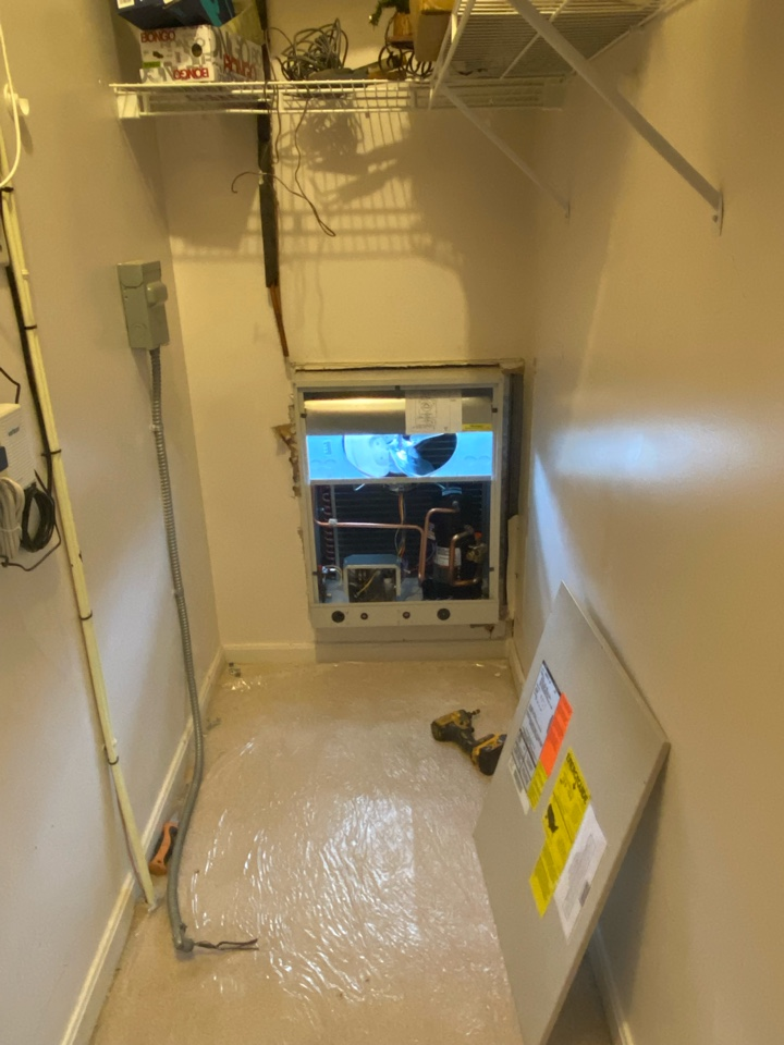 Annapolis, MD - Installing a new through the wall air conditioning unit in a condo building in Annapolis.