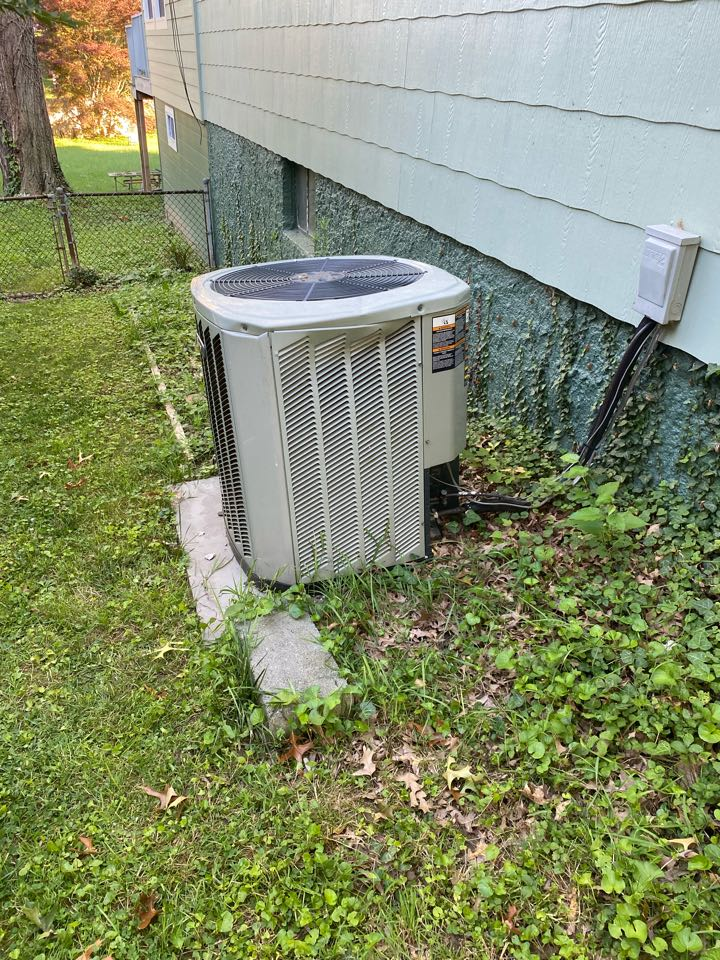 Baltimore, MD - We're making a repair on this -air conditioning equipment that was damaged from a fallen piece of wood during the recent storm.