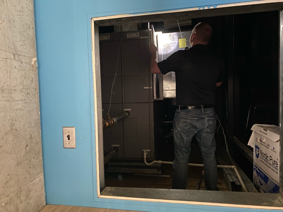 Baltimore, MD - Performing a preventative maintenance on an office HVAC system.
