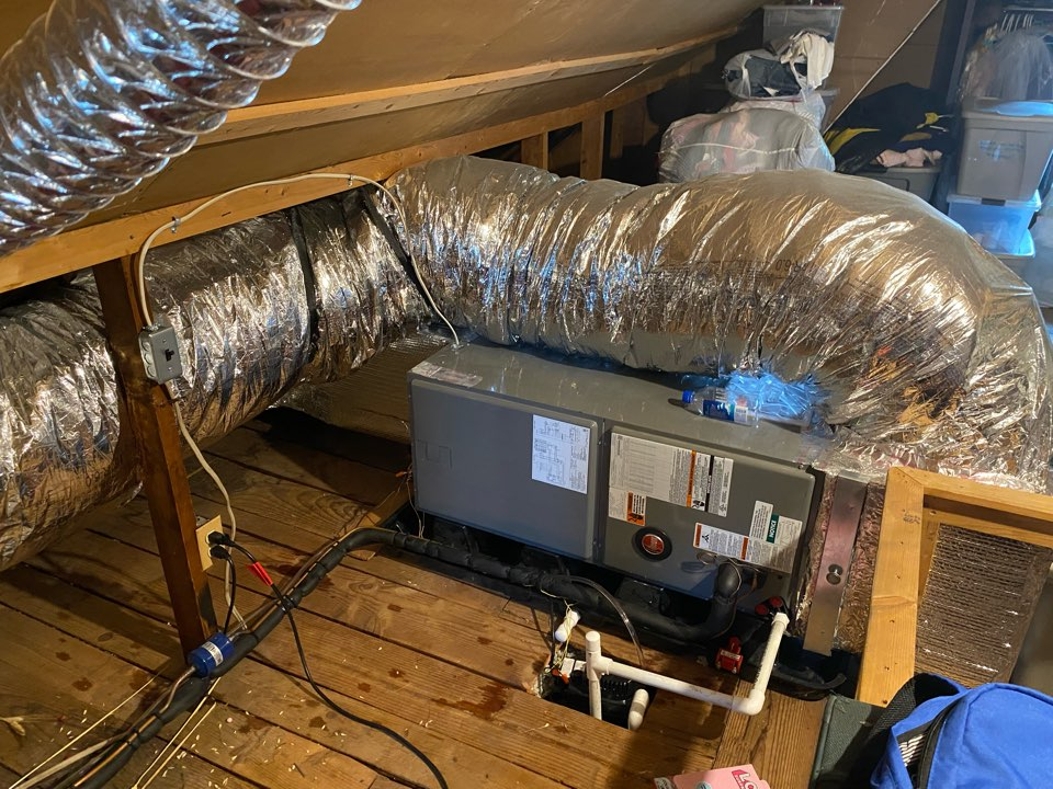 Baltimore, MD - Performing a repair on a condensate leak on the discharge line in the attic.