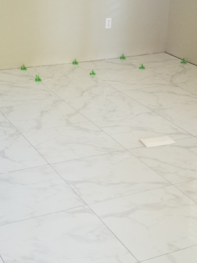 "Rio Linda, CA - italian tile 24""�24"" being laid in progress"