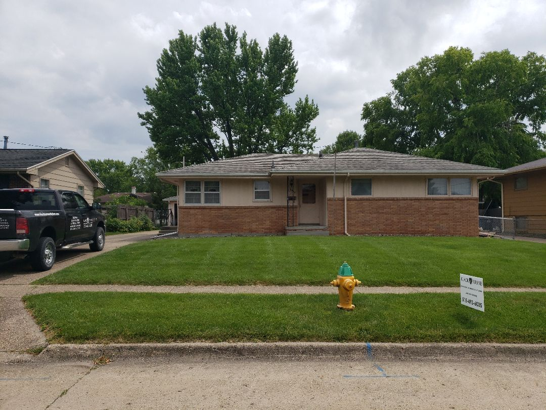 Des Moines, IA - Installing a new roof.