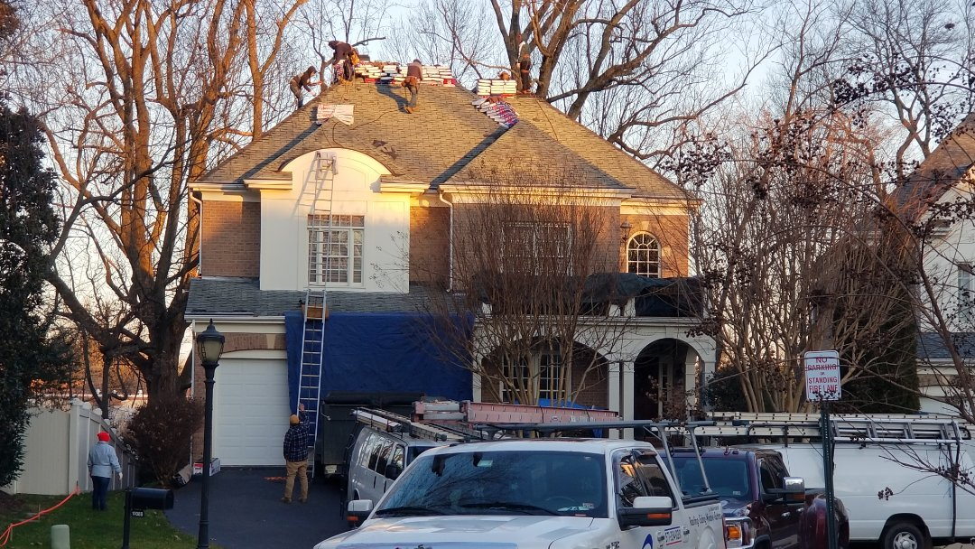 Fairfax, VA - Full roof replacement in Fairfax.  Removal and disposal of discontinued shingles and roofing material.  Replace with GAF architectural lifetime warranted shingles.  Gutter cleaning throughout the replacement.