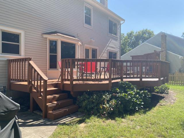 Herndon, VA - OHI accomplished a deck repair at this wonderful home, which included replacing a number of deck boards, a full power washing and application of one coat of sealer to this beautiful deck out in Herndon.