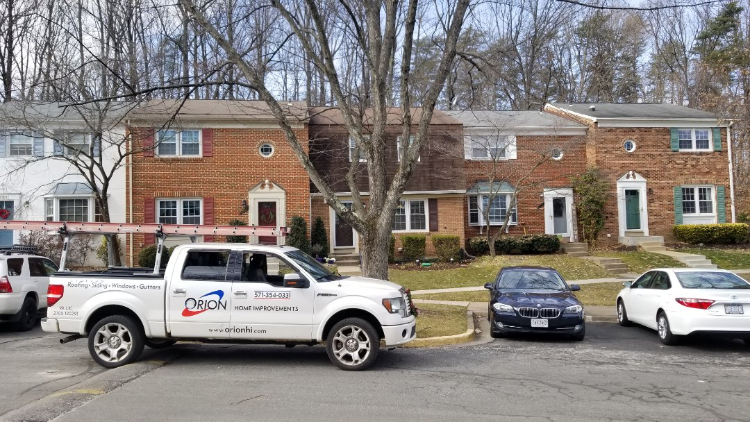 Springfield, VA - Roof replacement, wood trim replacement, and aluminum capping on a home in Springfield.  This is a Mandard style roof which requires a specific installation method. Upgrade to GAF lifetime warranted architectural shingles with extended warranty.