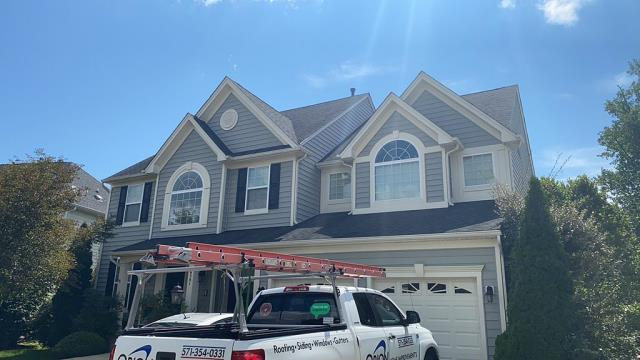Woodbridge, VA - OHI removed damaged ridge cap shingles and installed new GAF Snow Country Advanced ridge vent to this big, beautiful home in Woodbridge.