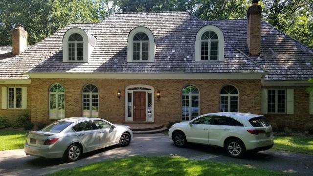 Fairfax Station, VA - OHI did a wonderful job removing all gutters, downspouts, and fascia with new aluminum k-style gutters, downspouts and primed fascia. Our team inspected the roof and replaced missing/damaged cedar shakes to bring this home back to gorgeous.