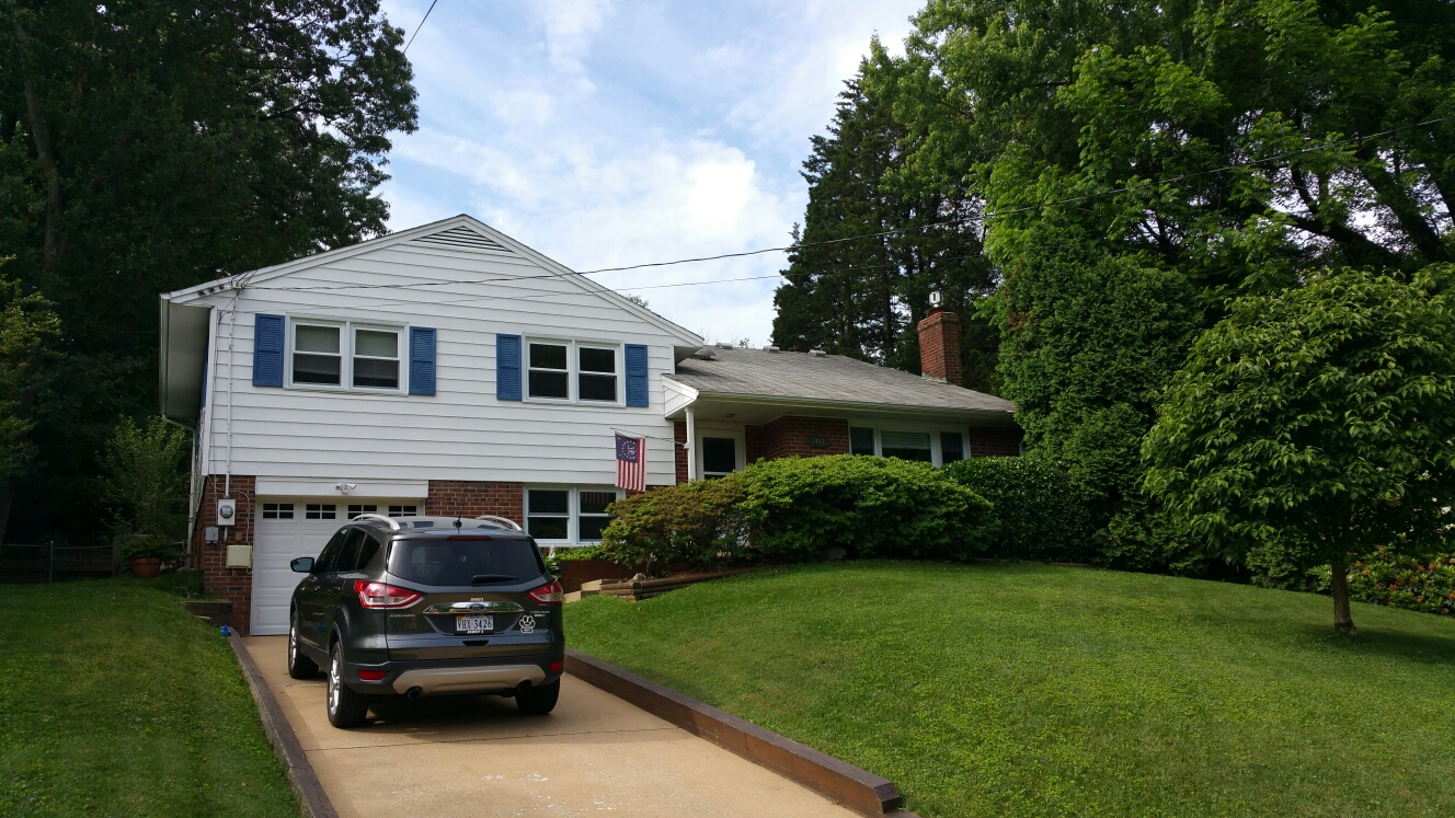 Springfield, VA - Full roof replacement. Rotten plywood everywhere.  Full gutter and downspout replacement. Installation of gutter screens. Full siding replacement.