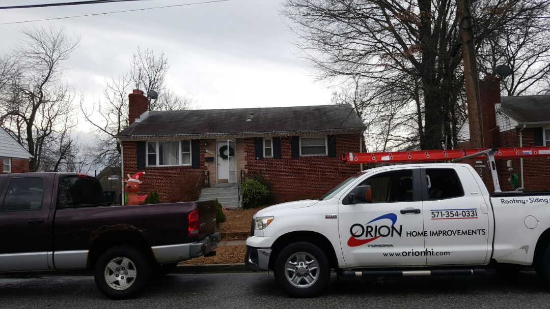 Hyattsville, MD - Full roof replacement for area with shingles and addition with a flat roof.