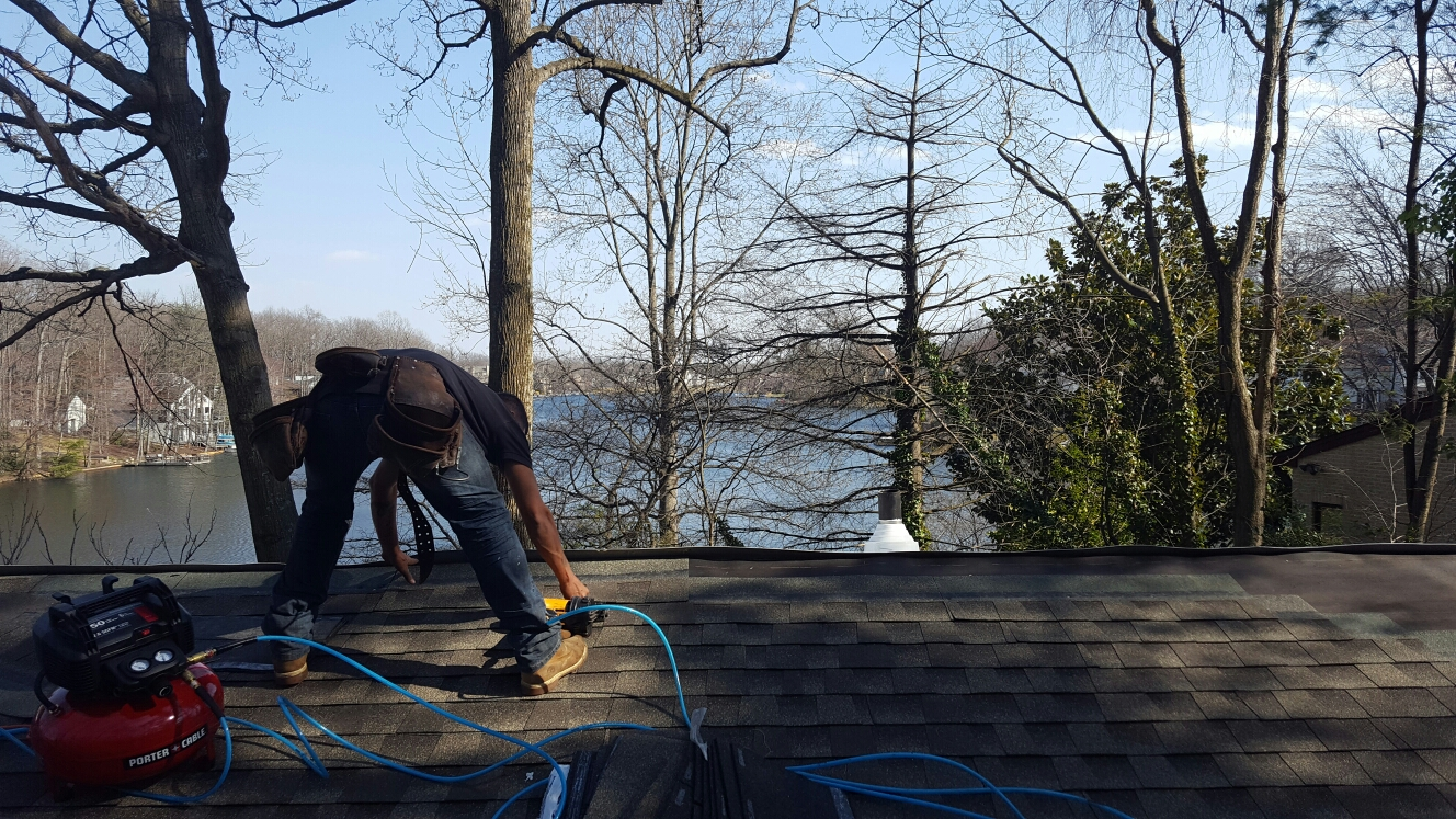 Reston, VA - Its a beautiful day to be working outside. Roofing with a view of the water. GAF TPO flat roof and Timberline HD shingle tie in.