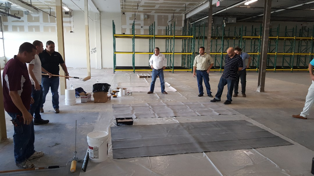 Springfield, VA - Flat roof sealing and coating.  Team members training and certification at facility in Springfield to better serve our customers