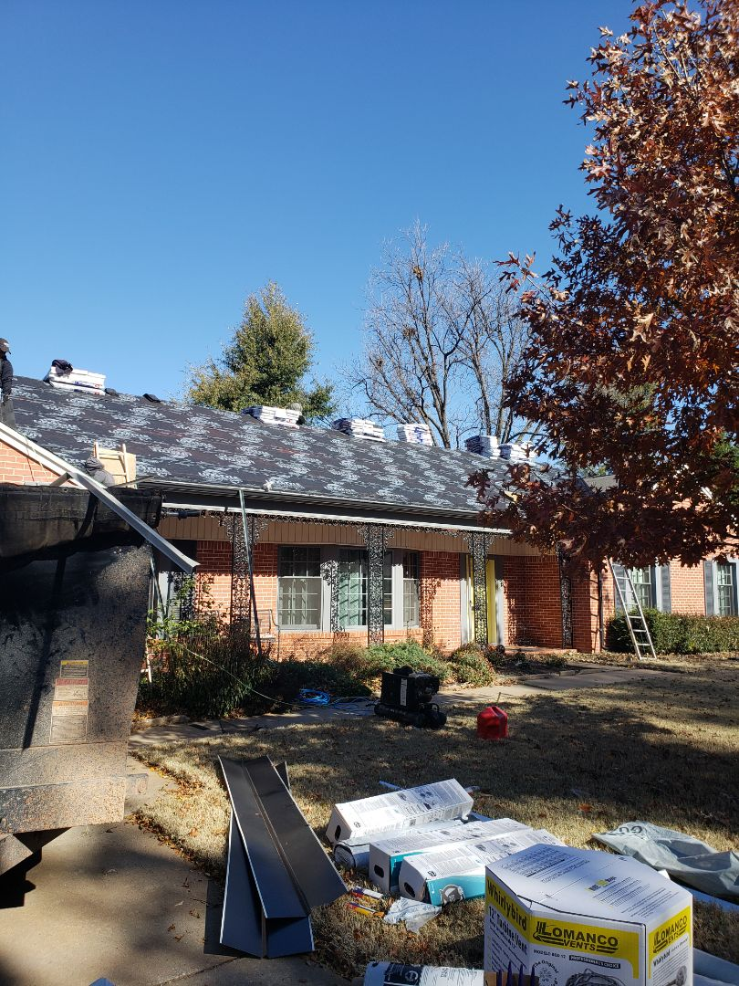 Oklahoma City, OK - Original roof was tattered with hail damage. Insurance covered the loss, and is being replaced with GAF Timberline HD laminated architectural shingle.