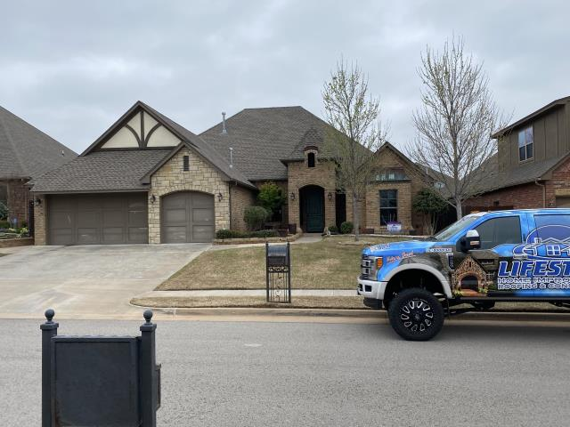 Edmond, OK - We are going to Roof pastor Hays's house with GAF Lifestyle Shingles and use high profile Z ridge. We are going to paint the whole house and then put seamless guttering all the way around. Thank you Pastor Hays we really appreciate your business.