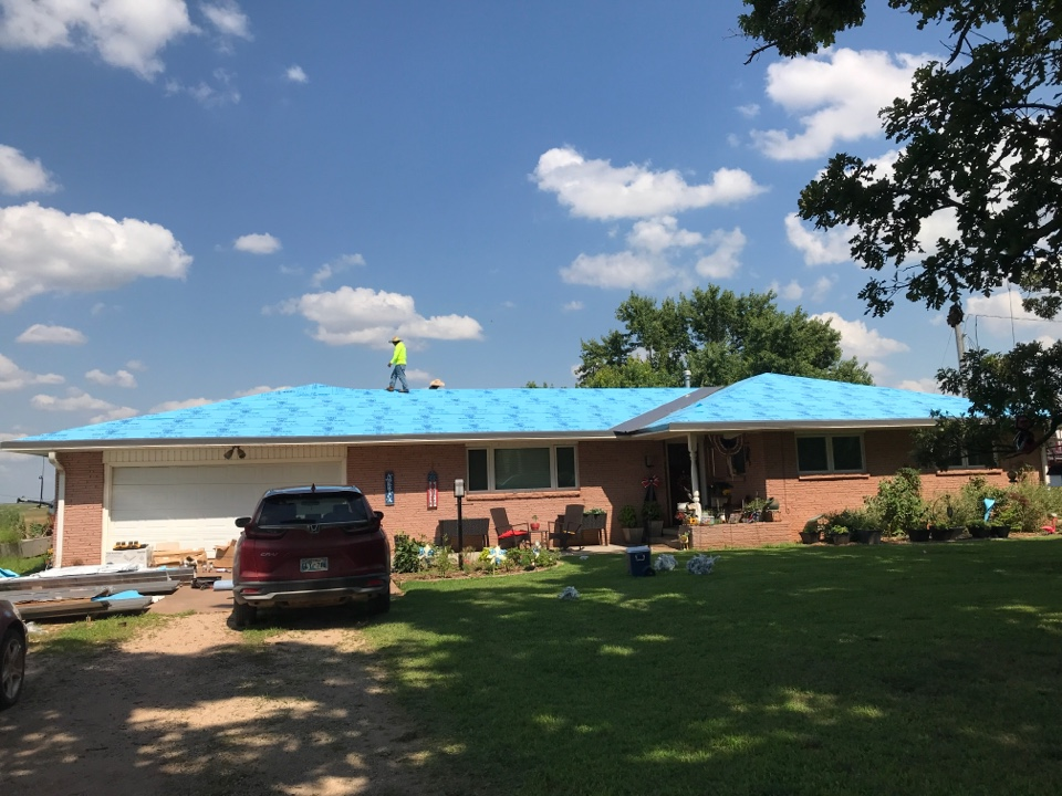 Perry, OK - Getting started on a new metal project. This roof was damaged by hail and the Home owners wanted to go back with something more impact resistant. So, we're installing a metal R-panel in charcoal grey.