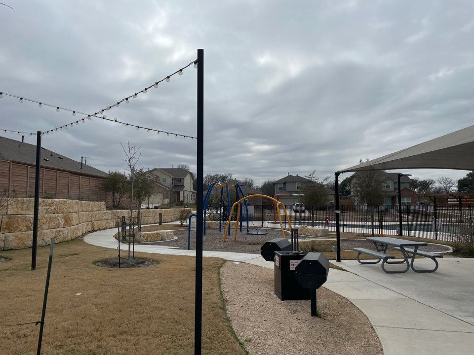Austin, TX - This LawnPop Artificial Grass project is going to enhance this south Austin community. The playground will be utilizing LawnPop synthetic turf around the pool and common area. The homeowners will have a place that is clean and free of mud and dirt to let the kids and pets play. The community will start saving money and resources by using LawnPop artificial turf.
