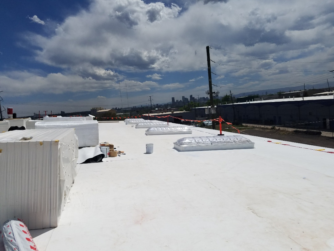 Denver, CO - Working on a metal building recover going back with a fully adhered 60Mil TPO and new commercial skylights