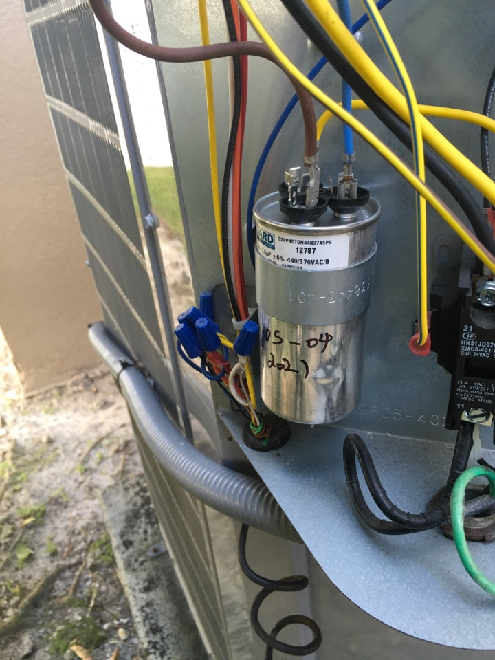 Winter Garden, FL - Replaced condenser capacitor on Carrier system for a family in Winter Park neighborhood.  Repair complete and system is functioning properly again!