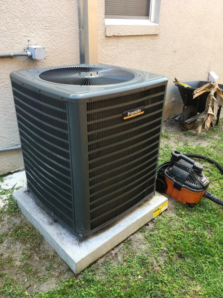 Winter Garden, FL - AC Maintenance Apopka, FL - Performing maintenance on a condenser.