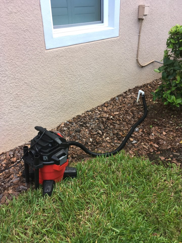 DeLand, FL - AC Repair DeLand - Clearing a drain line on an AC System in Deland.