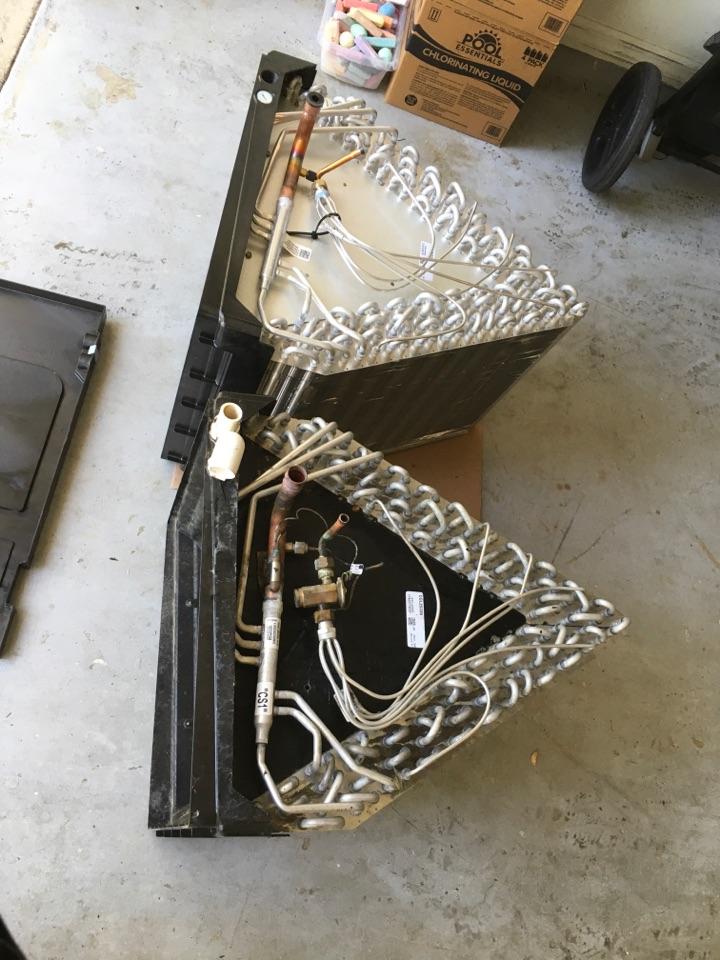 Apopka, FL - AC Repair Apopka - Replacing an evaporator coil and drain pan in Apopka.