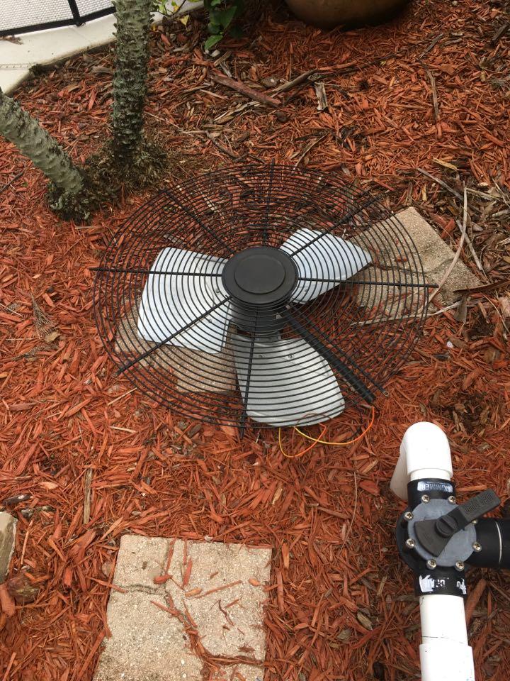 Winter Springs, FL - AC Repair Winter Springs - Replacing a condenser fan motor and blade in Winter Springs
