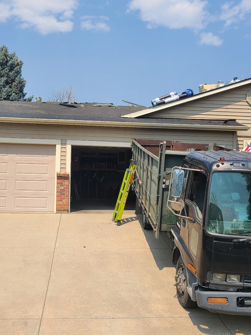 Arvada, CO - New roof, gutters, skylights, fascia and staining!