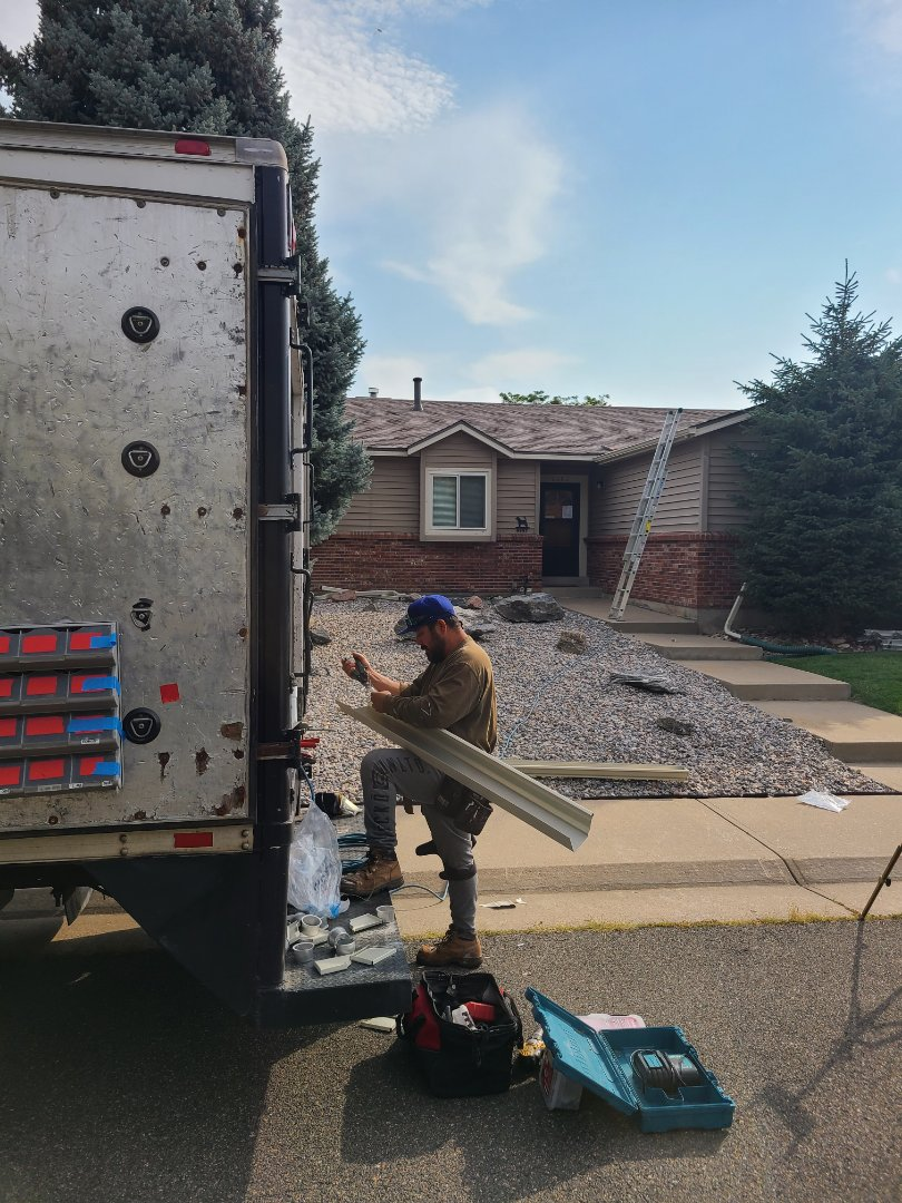Arvada, CO - Roof is done! Gutters being installed